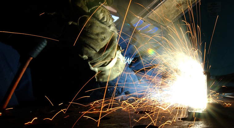 A Man Using Welder