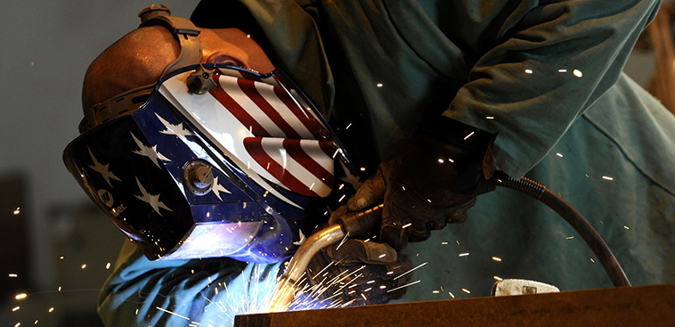 Man Wearing Welding Mask With American Flag Design