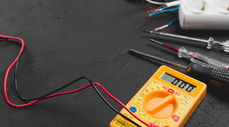 A photo of a multimeter on a desk