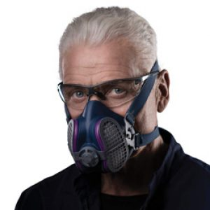 a man wearing a reusable respirator