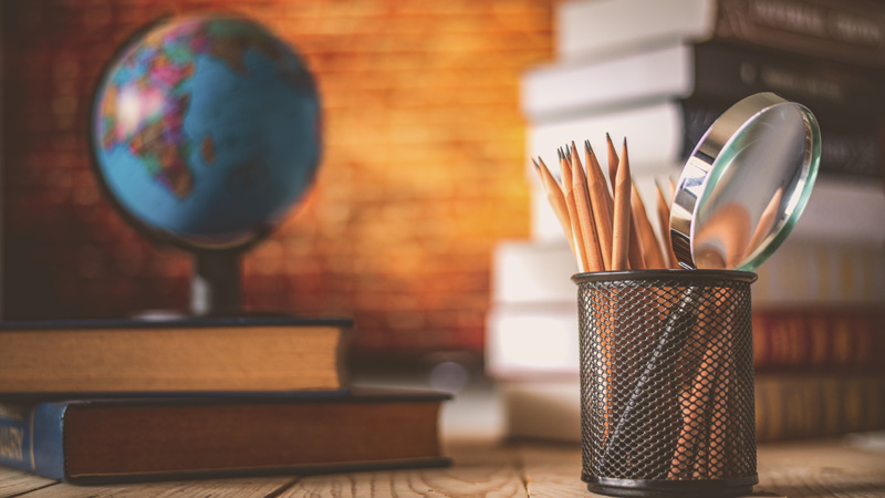 books, pencils and a globe