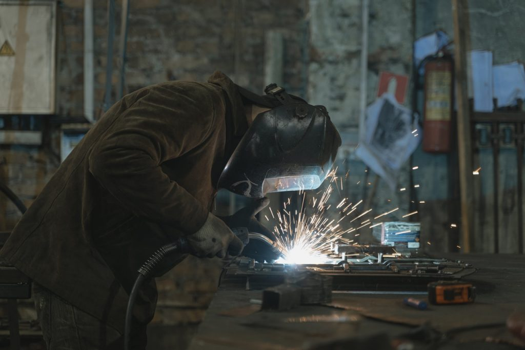 a person welding with sparks visible